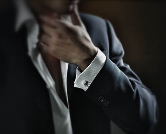 The man in a suit on a black background.Special film grain.Special Concept style, processing.